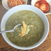 """abalone porridge. the green color comes from their intestines and """"poop"""" which is just digested seaweed :P"""